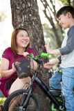 Little Asian child with mother practice to riding a bicycle Stock Photography