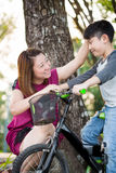 Little Asian child with mother practice to riding a bicycle Royalty Free Stock Image
