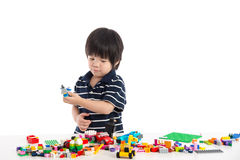 Little asian child playing with colorful construction blocks Royalty Free Stock Photography