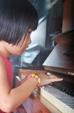 Little asian child playing the piano Stock Image