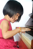 Little asian child playing the piano Stock Photography