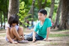 Little Asian child playing sand in the park Stock Photography