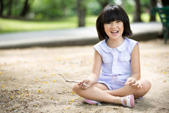 Little Asian child playing sand in the park Royalty Free Stock Photos