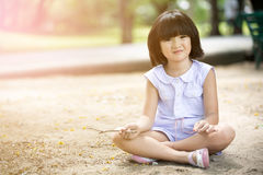 Little Asian child playing sand in the park Stock Photos