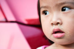 Little Asian child sick with flu sneezing. Closeup eye. Royalty Free Stock Photography