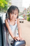 Little asian child sitting in the car Stock Photography