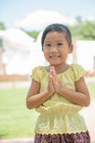 Little Asian child welcome expression Sawasdee. Stock Photo