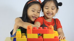 Little Asian children playing with blocks stock video footage