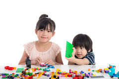 Little asian children  playing with colorful construction blocks Stock Photo