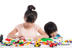 Little asian children  playing with colorful construction blocks Stock Photos