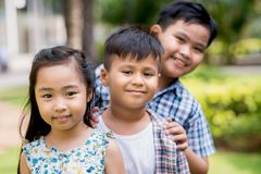 Little Asian children. Standing in a row and looking at the camera Stock Image
