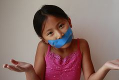Little Asian Chinese girl with tape Royalty Free Stock Images