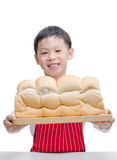 Little Asian cook with bread Royalty Free Stock Images