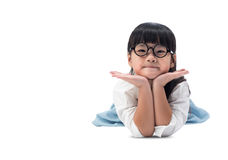 Little Asian cute girl laying on the floor isolated with clipping path. Royalty Free Stock Photos