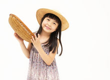Little asian girl with basket Stock Images