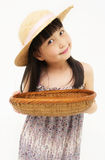 Little asian girl with basket Royalty Free Stock Photography