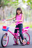 Little asian girl with bicycle Royalty Free Stock Photography