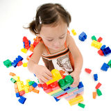 Little Asian girl with blocks royalty free stock photos