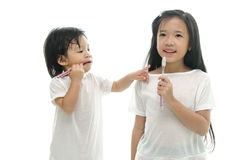 Little  asian girl and boy brushing teeth Stock Images