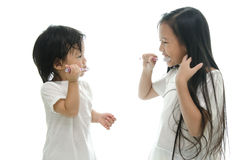 Little  asian girl and boy brushing teeth Royalty Free Stock Image