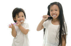 Little  asian girl and boy brushing teeth Royalty Free Stock Photos