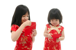 Little asian girl and boy holding red packet monetary gift Royalty Free Stock Photography