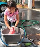 Little asian girl with bucket stock photos