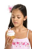 Little Asian girl and cake Stock Image