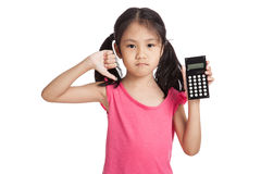Little asian girl  with a calculator Royalty Free Stock Image