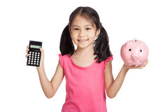 Little asian girl  with a calculator and piggy bank Royalty Free Stock Image