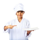 Little asian girl chef showing the empty white plate Royalty Free Stock Photos