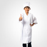 Little asian girl chef showing thumb up Royalty Free Stock Photo