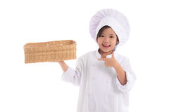 Little asian girl chef in uniform Royalty Free Stock Photo