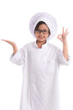Little asian girl chef in uniform Royalty Free Stock Photography