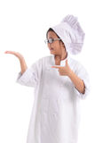 Little asian girl chef in uniform wearing glasses Royalty Free Stock Image