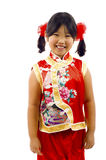 Little Asian Girl - Chinese New Year. Little Asian girl wearing a traditional red dress to celebrate Chinese New Year, isolated over white