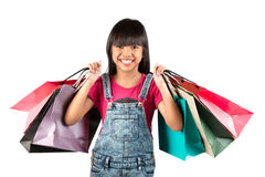 Little asian girl with colorful shopping bags Stock Images
