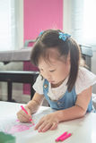 Girl coloring with wooden pencils at the school Royalty Free Stock Photo