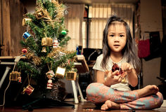 Little Asian Girl is Decorating Christmas Tree Stock Photos
