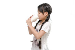 Little asian girl drinking milk Royalty Free Stock Photography