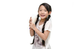 Little asian girl drinking milk Royalty Free Stock Images