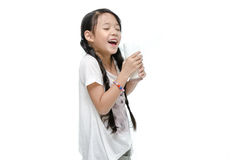 Little asian girl drinking milk Stock Image