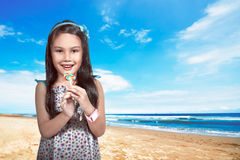 Little Asian Girl Eat Lollipop Stock Photo
