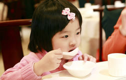 Little asian girl eating Royalty Free Stock Photo