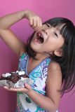 Little asian girl eating cherry Stock Photography