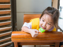 Little Asian girl eating ice cream Royalty Free Stock Photos