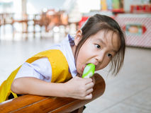 Little Asian girl eating ice cream Royalty Free Stock Photo