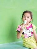 Little Asian girl eating ice cream. In summer Stock Photo