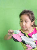 Little Asian girl eating ice cream. In summer Royalty Free Stock Images