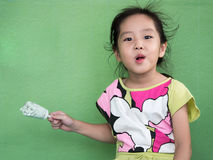 Little Asian girl eating ice cream. In summer Royalty Free Stock Image